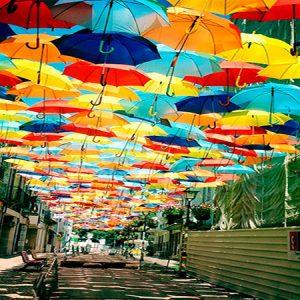 Colorful UMBRELLA ART installation at the Agitagueda Festival