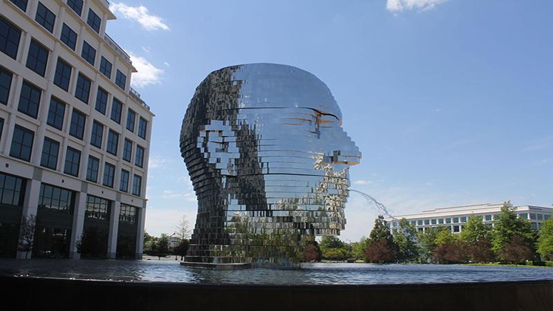 Metalmorphosis – Giant Metal Head Kinetic Sculpture in Charlotte